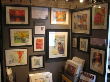 Left side of gallery booth with framed watercolor paintings